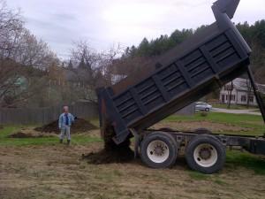 May 9, 2014:  Chris guides the big manure dump
