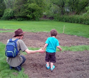 Jason and his son in the garden