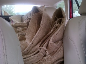 Back of station wagon full of coffee bags