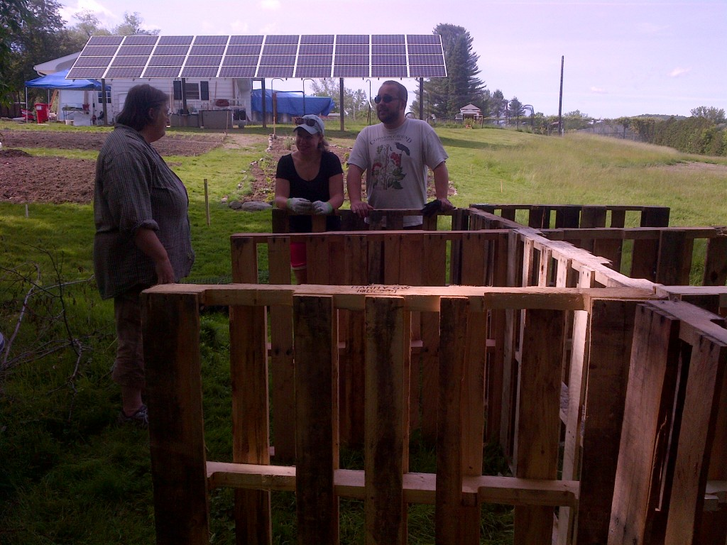 A second team gets started on doors for the compost bins.