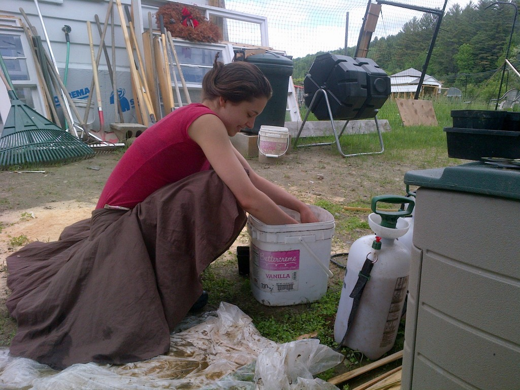 Mixing potting soil to start the vining plants, like winter squashes, summer squashes, and cucumbers