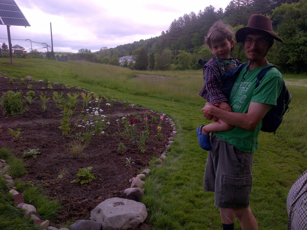 Father and son take a Father's Day break by the herbs