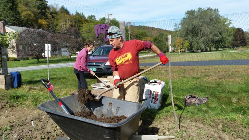 Lawrence and Albert mix the soil in the summer and winter squash boxes. We've harvested most of our squashes for the year.
