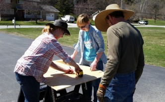2016-04-30 Hannah, Emma & CA measure plywood for bins.28